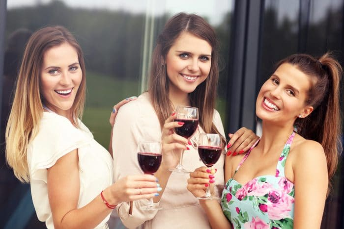 Young women drinking Red wine
